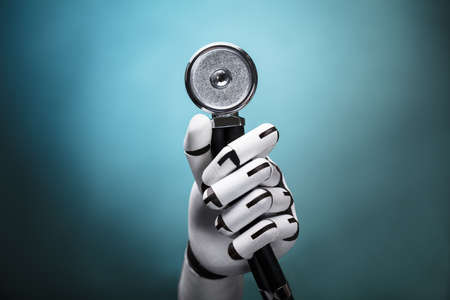 Photo pour Close-up Of A Robot's Hand Holding Stethoscope On Colorful Background - image libre de droit