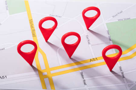 Foto de High Angle View Of A City Map With Red Location Marker - Imagen libre de derechos