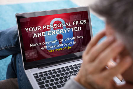 Photo for Close-up Of A Person Looking At Laptop Screen Showing Personal Files Encrypted Text - Royalty Free Image