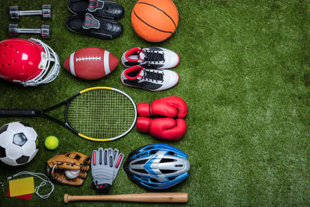 High Angle View Of Various Sport Equipments On Green Grass