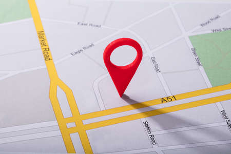 Photo for High Angle View Of Navigation Map With Red Pin Pointer - Royalty Free Image