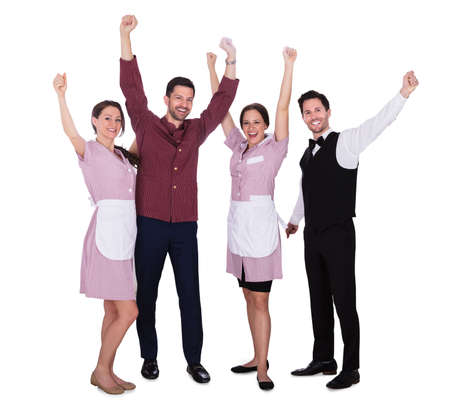 Photo pour Happy Young Staff Raising Their Arms On White Background - image libre de droit