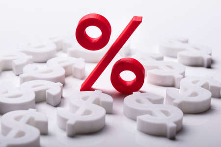 Foto de Red Percentage Symbol Surrounded By Dollar Sign - Imagen libre de derechos
