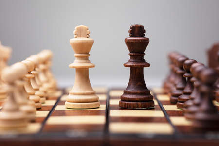 Photo for Brown And White King Chess Piece On Board Game - Royalty Free Image