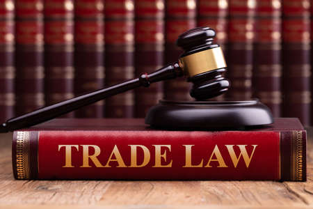 Photo for Soundboard And Gavel On Trade Law Book Over Wooden Table - Royalty Free Image
