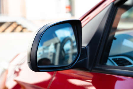 Photo for Rear View Mirror Of A Car Driving On Street - Royalty Free Image