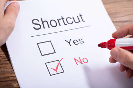 Photo pour A Person Holding Marker Over Paper With Shortcuts Word Showing Yes And No Option - image libre de droit