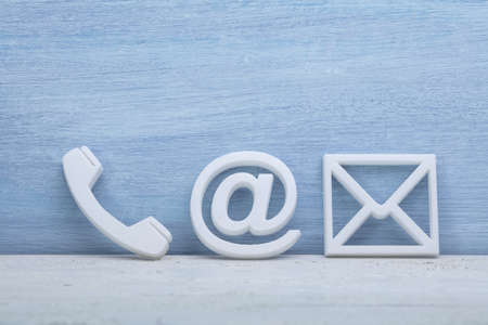 Photo pour Close-up Of A Phone, Email and Post Icons. Contact us - image libre de droit