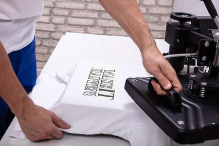 Photo for Man printing on t shirt in workshop - Royalty Free Image