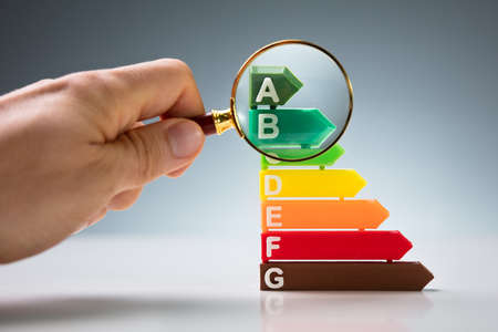 Photo for Magnifying Glass Over Energy Efficiency Rating Chart - Royalty Free Image