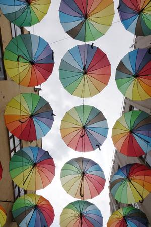 Foto de Colorful umbrellas background. The sky of colorful umbrellas - Imagen libre de derechos