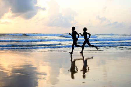 Foto de Woman and men running during sunset  - Imagen libre de derechos