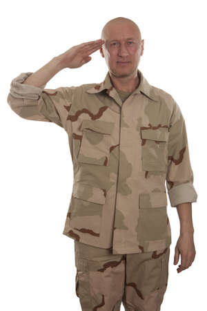 Marine in camouflage uniform saluting on a white background