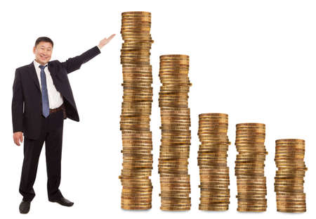 Asian businessman standing next to gold coins