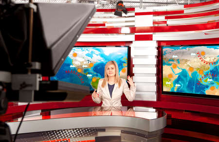 Photo pour Weather forecast. A television anchorwoman at studio during live broadcasting - image libre de droit