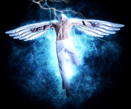 Photo for A man with wings on electricity light background. Design for cover book, poster - Royalty Free Image