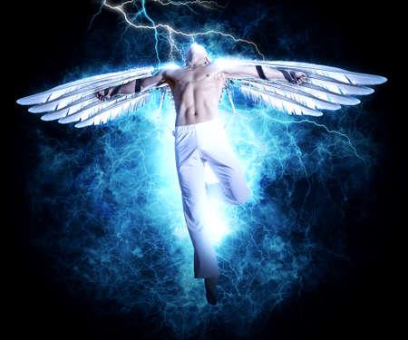 Foto de A man with wings on electricity light background. Design for cover book, poster - Imagen libre de derechos
