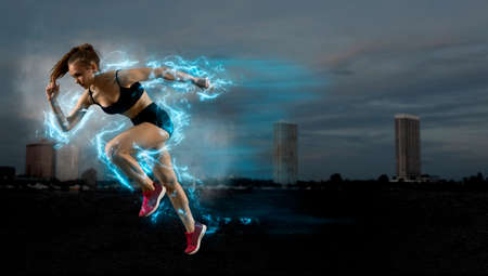 Photo for Woman sprinter leaving starting blocks on the athletic track. Exploding start - Royalty Free Image
