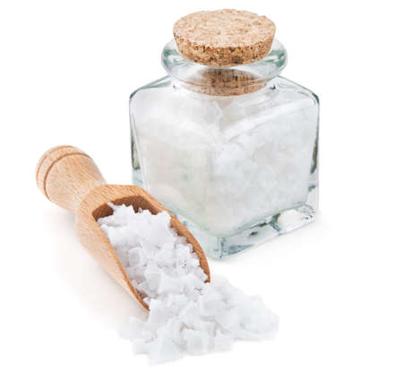 Photo pour Cyprus sea salt flakes in a glass bottle isolated on white background - image libre de droit