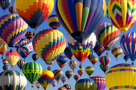 Photo for The mass ascension launch of over 100 colorful hot air balloons at the New Jersey Ballooning Festival in Whitehouse Station, New Jersey as a early morning race. - Royalty Free Image
