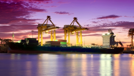 Photo pour Container Cargo freight ship with working crane bridge in shipyard at dusk for Logistic Import Export background - image libre de droit