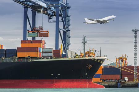 Foto de Container Cargo freight ship with working crane loading bridge in shipyard at dusk for Logistic Import Export background - Imagen libre de derechos