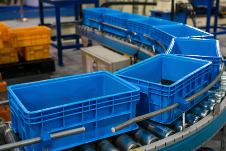 Photo pour Plastic box on roller line for tranfer production part in prodine lin in factory, production, transportation concept - image libre de droit
