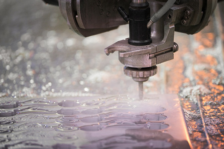 Foto per Hydroabrasive treatment. Metalworking cutting with water jet - Immagine Royalty Free