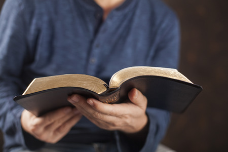 Foto de Man reading from the holy bible, close up - Imagen libre de derechos