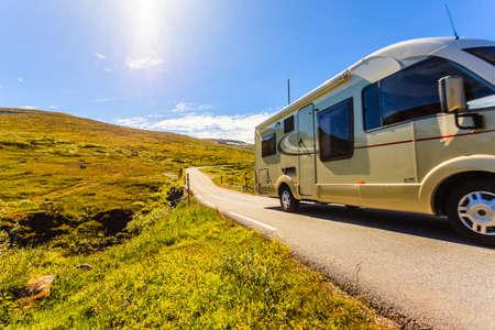 Photo pour Tourism vacation and travel. Camper van on road, summer mountains landscape. National tourist route Aurlandsfjellet. - image libre de droit
