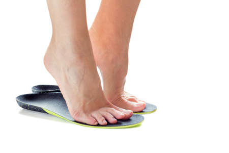 Photo pour female feet stand on their toes in orthopedic insoles - image libre de droit