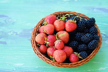 Photo for Blackberries and strawberries from the garden on a wooden background - Royalty Free Image