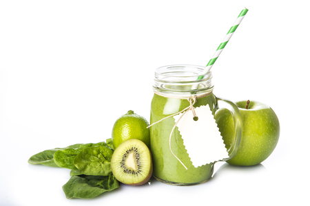 Photo pour Fresh homemade green smoothie and ingredients isolated on a white background - image libre de droit