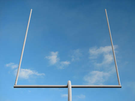 American football field goal posts against the blue sky. mural