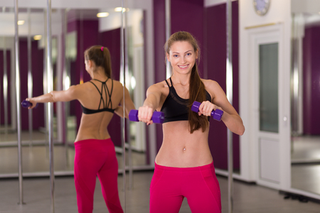 Beautiful  active woman working out at the fitness studio