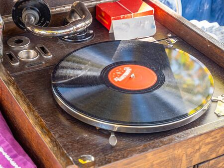 Photo for Old vintage turntable with a vinyl record - Royalty Free Image