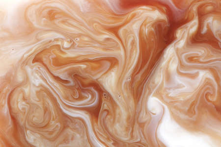Photo for Mixing coffee with milk, macro - Royalty Free Image
