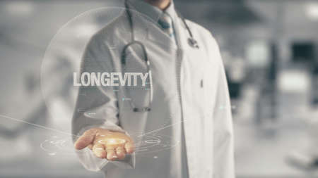 Photo pour Doctor holding in hand Longevity - image libre de droit