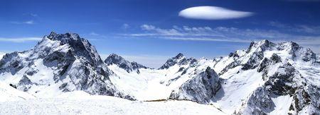 Panorama Caucasus Mountains. Dombaj. View from the ski resort.