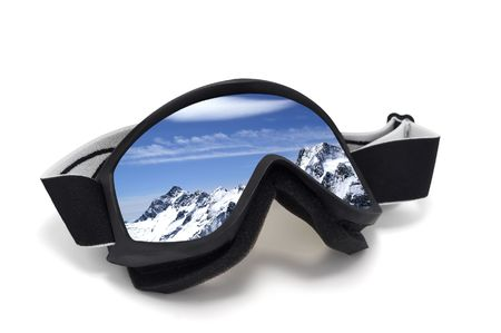 Ski goggles with reflection of mountains. Isolated on white background