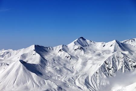 Snowy mountains and blue sky. Caucasus Mountains, Georgia, region Gudauri.
