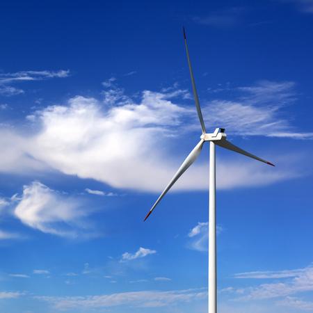 Foto de Wind turbine and blue sky with clouds at sun windy day - Imagen libre de derechos