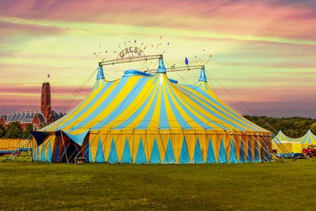 Photo for Circus tent under a warn sunset and chaotic sky - Royalty Free Image