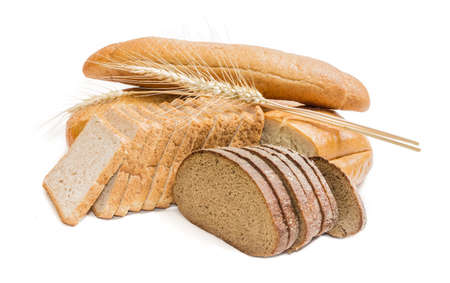 Foto de Bread with bran, sliced bread for toasting, wheat bread, sliced brown bread and spikelets of wheat on a light . Isolation - Imagen libre de derechos