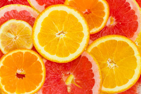Photo pour Background of the round slices of the ripe various citrus with their peel closeup  - image libre de droit