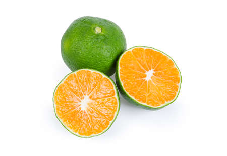 Photo pour Whole ripe green tangerine and tangerine cut across in half on a white background - image libre de droit