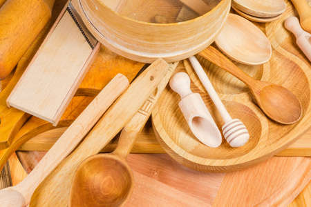 Photo for Pile of various kitchen utensils made from different natural wood type, fragment close-up - Royalty Free Image