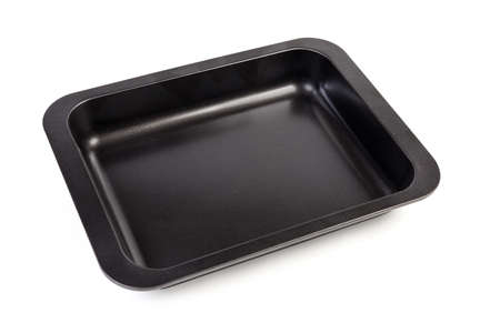 Foto de Empty rectangular metal oven tray with rim and nonstick coating on a white background - Imagen libre de derechos