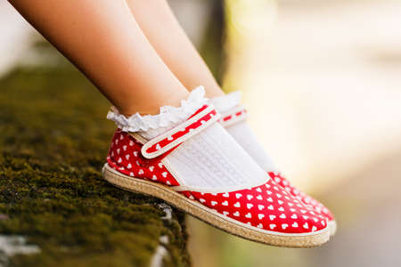Photo for Close up of red polka dot shoes on child's feet - Royalty Free Image