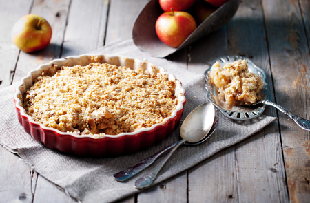 Photo for Apple crumble on the wooden background with apples - Royalty Free Image